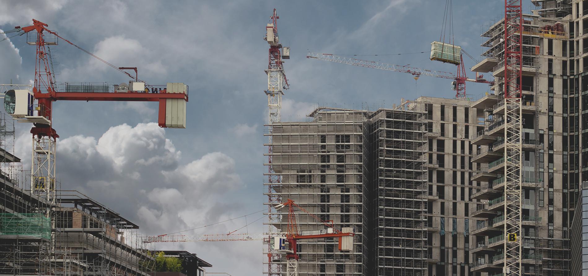 Proingbygg byggnadsplats med kran